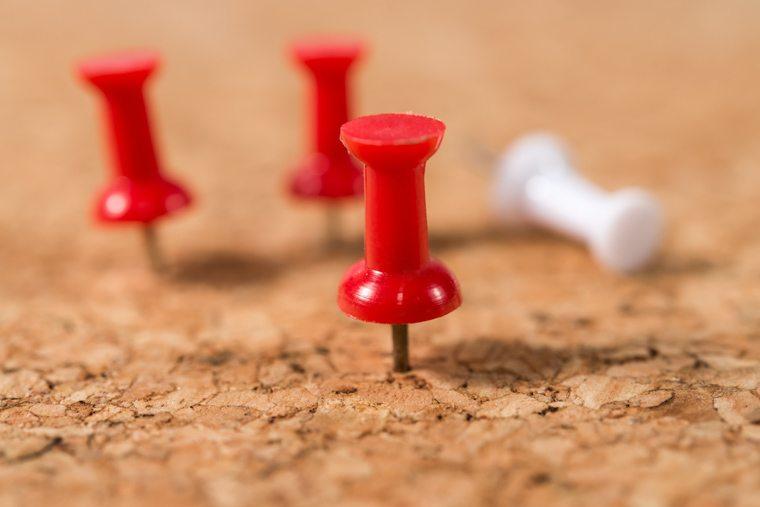 red-pin-on-cork-board