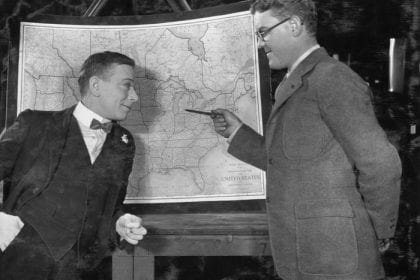 Men pointing at map