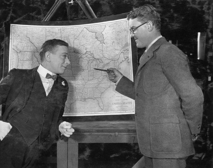 Men pointing at map