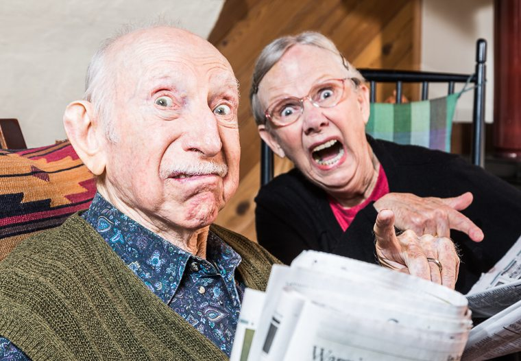 elderly-couple-shocked-at-newspaper