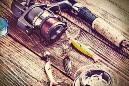 fishing rod and three fish shaped baits
