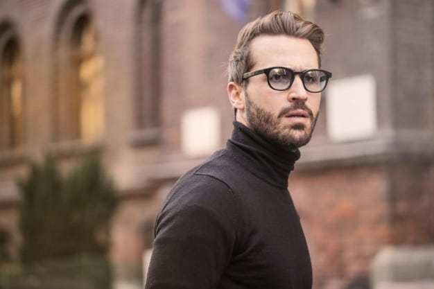 man with glasses in turtleneck
