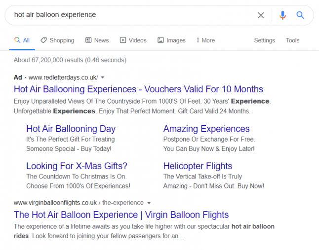 An example of a paid search result appearing above an organic result for a hot air balloon experience search query.